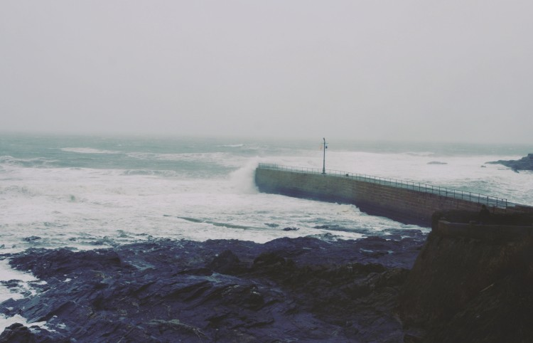 Waves breaking over Porthleven pier in a storm, Cornwall. Travel blog